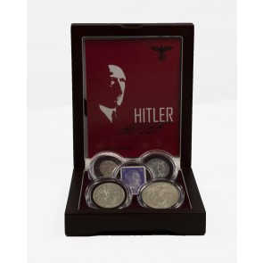 Adolf Hitler: A collection of four coins and one stamp